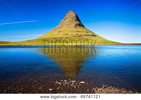 Mountain Kirkjufell and its reflection in the water. Grundarfjordur Snaefellsnes peninsula Western Iceland poster