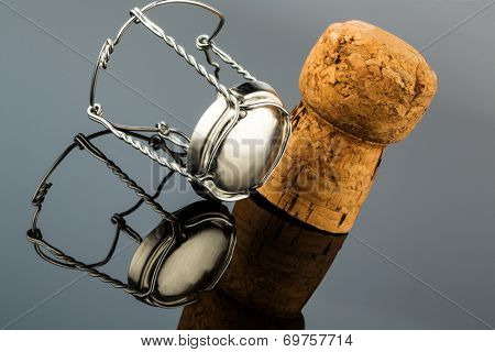 champagne corks and clasp, symbol photo for celebrations, enjoyment and consumption of alcohol