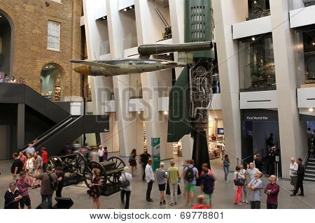 LONDON - AUGUST 1: Visitors view exhibits in the atrium of the newly refurbished Imperial War Museum on August 1, 2014 in London, UK