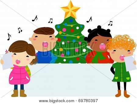 Group of children singing around a Christmas tree and banner
