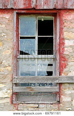 Broken Old Window On Abandoned Barn Background