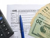 fill out the 1040 us individual tax return form. blue pen, different green american dollars heap (ten, twenty banknones)  and calculator. fill out the 1040 us individual tax return form. blue pen, different green american dollars heap (ten, twenty banknon poster
