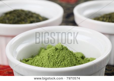 White bowls with green teas - focus on matcha green tea powder poster