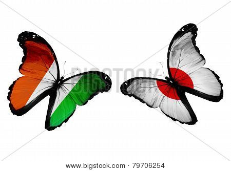 Concept - Two Butterflies With Cote Divoire And Japan Flags Flying, Like Two Football Teams Playing