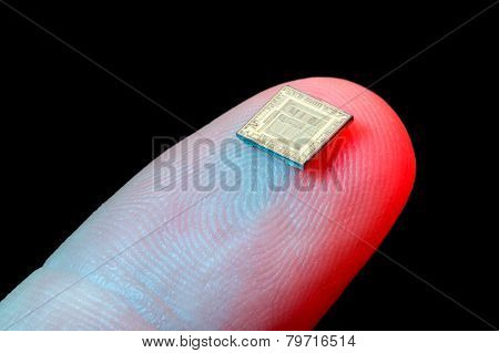 Silicon micro chip on human finger's tip poster