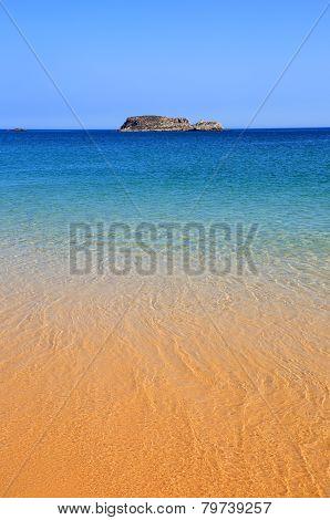 Turquoise sea and deserted Algarve beach.