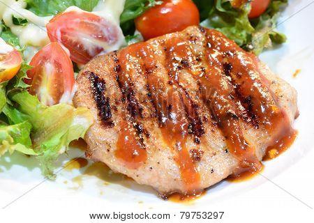 Grilled steaks, and vegetable salad