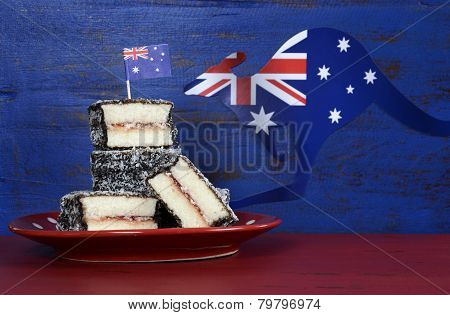 Happy Australia Day January 26 party food with iconic Australian lamington cakes on dark red and blue vintage rustic recycled wood background. poster