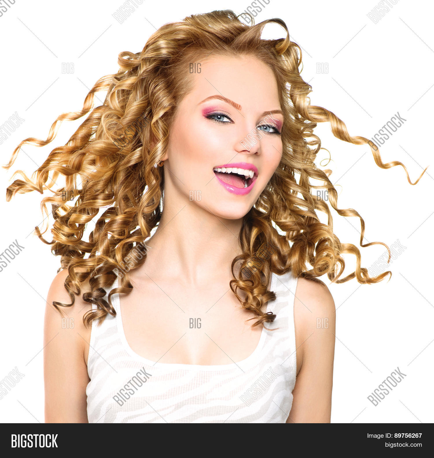 Portrait of a beautiful woman with long curly hairs