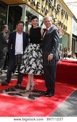 LOS ANGELES - MAY 1:  Michael J. Fox, Julianna Margulies, Les Moonves at the Julianna Margulies Hollywood Walk of Fame Star Ceremony at the Hollywood Boulevard on May 1, 2015 in Los Angeles, CA