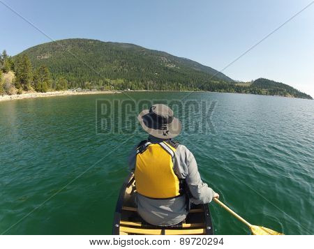 Canoeist on quiet Flathead Lake