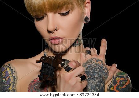 Tattooed Young Woman With Tattoo Machine
