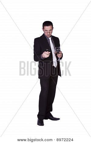 Businessman With A Glass Of Drink Texting Looking At The Camera