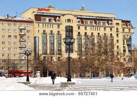 NOVOSIBIRSK, RUSSIA - JANUARY 23, 2015: People near the hotel Marriott in a winter day. Marriott has more than 3,700 locations in 75 countries and territories worldwide