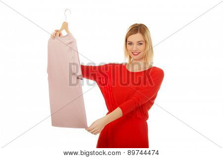 Beautiful woman thinking what to wear.