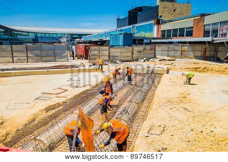 Unidentified construction workers building new terminal in the international airport el dorado bogot