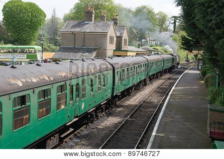 Vintage steam train waits to depart the station