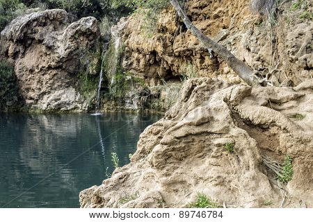 Beautiful Waterfall With Small Lake In Famous Hidenn Natural Picnic área, Called Pego Do Inferno