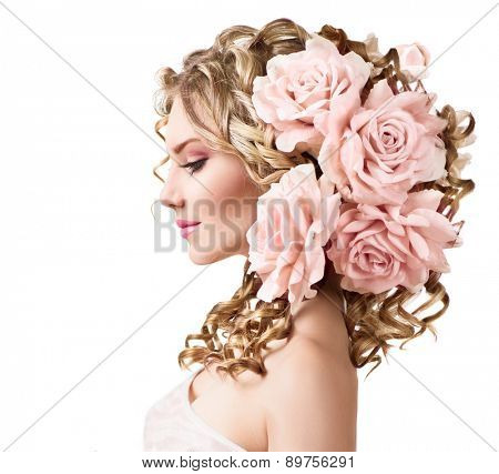 Beauty girl with rose flowers hairstyle isolated on white background. Fantasy girl portrait with pink flowers. Summer fairy portrait. Long permed curly hair. Perfect make up