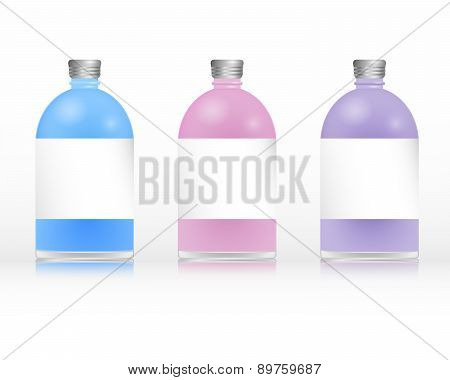 Three plastc bottles of shampoo with metal caps poster