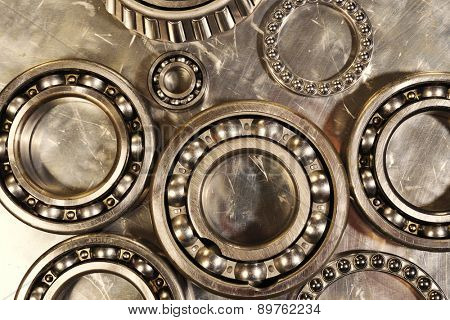 ball-bearings and pinions in titanium and steel, engineering concept in copper toning concept