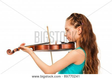 Half-face of girl with long hair playing violin