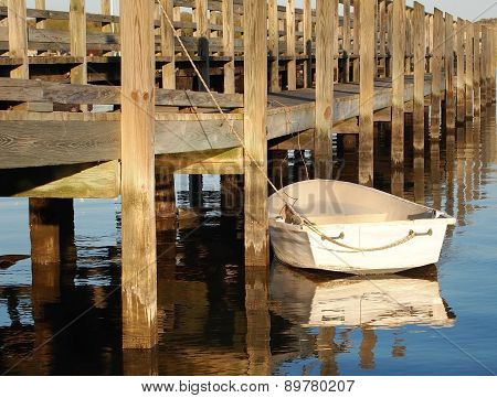 White Rowboat At The Pier