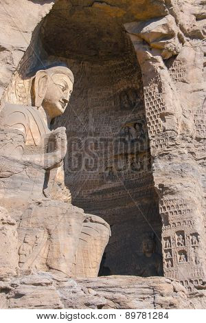 Stone Buddha Sculpture In The Cave