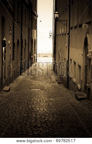 Colorful rustic Alley with Cobblestone road Stockholm - Sweden poster