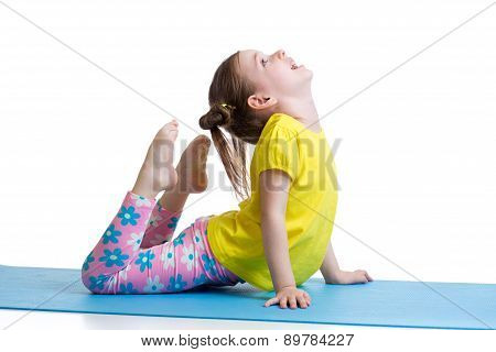 Child girl doing gymnastic exercises on mat isolated poster