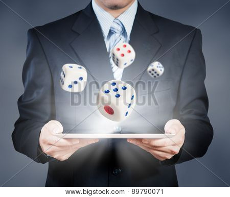 Businessman Using Tablet Showing Dice, Risk Management Concept
