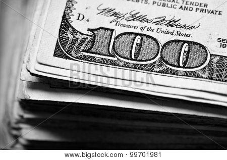 Closeup of hundred dollar bill money cash with corner of paper focussed