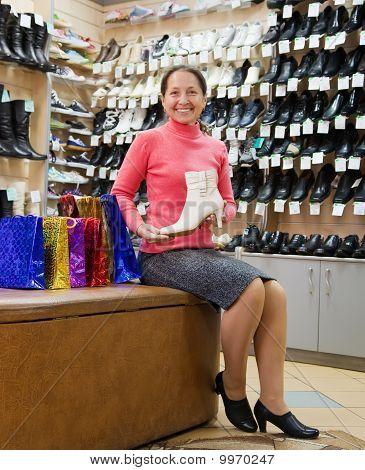 Woman Shopping At  Shoe Store