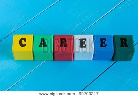 Word Career on children's colourful cubes or blocks. Colourful wooden background