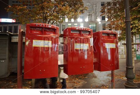 .the Red Mailboxes On Street..