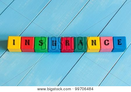 Word Insurance on children's colourful cubes or blocks. Business background