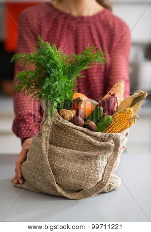 Closeup Of Burlap Sac Filled With Fall Vegetables With Woman