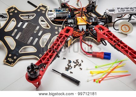 FORT COLLINS, CO, USA, JULY 20,  2015:  Repairing and rebuilding a drone after a crash - a partially disassembled DJI F550 Flame Wheel hexacopter with a  screwdriver and screws in front.