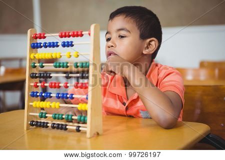 Student using a maths abacus at the elementary school