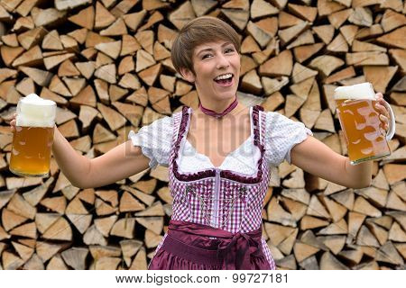 Vivacious Woman In A Dirndl With Two Beers