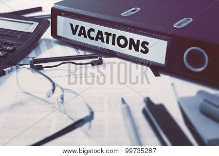 Vacations on Office Folder. Toned Image.