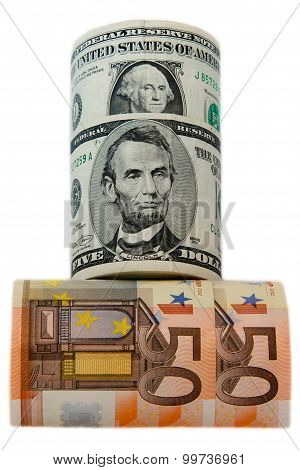 currency dollars and euros rolled on the white background