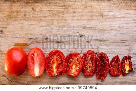 Sequential stages of tomato drying from fully fresh to almost dehydrated poster