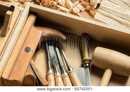 Woodworking and carpentry tools in workshop. poster