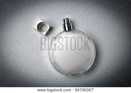 Stylish Perfume On A Gray Background