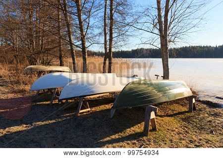 Rowboats in winter storage