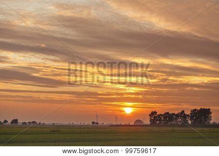 Lower Saxony bog landscape at sunset, wind turbines at horizon