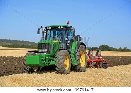 John Deere 6630 Tractor And Agrolux Plow On Field