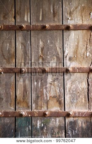 surface of a big old wooden gate