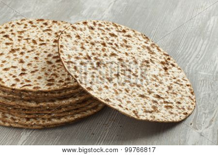 Pile of fresh wholewheat matzah close up